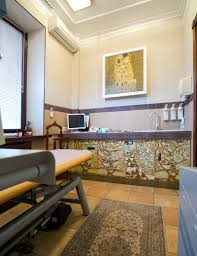 the interior of an ultrasound room is designed using the themes of