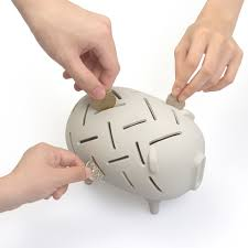his and piggy bank hungry piggy bank has 25 coin slots technabob