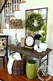 boxwood wreath in the foyer and a giveaway foyers wreaths and