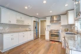 white kitchen cabinets with stainless steel backsplash gorgeous white kitchen room with moroccan tiles backsplash and