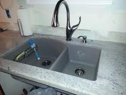 slab sink light granite recommendations for white shaker cabinets