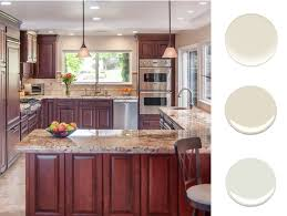 what paint color goes best with cherry wood cabinets new paint for a kitchen with cherry cabinets decorist
