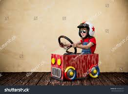 kid play car child driving car made cardboard box stock photo 450428557