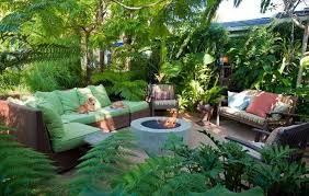 round concrete fire put and comfortable wicker sofa using green