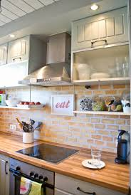 faux stone kitchen backsplash light brown brick back splash plus floating white wooden shelves