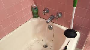Best Way To Unclog Bathtub Drain How To Unclog A Bathtub Drain With Standing Water Using A Coat