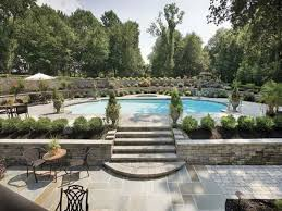swimming pool with shrubs and urns outdoor swimming pool