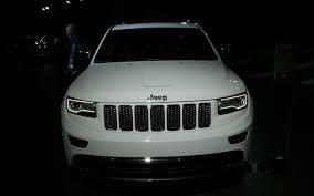 white jeep grand cherokee first look 2014 jeep grand cherokee automobile magazine