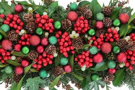 christmas flora with red bauble decorations holly ivy mistletoe