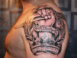 dagger in hand and crown tattoo on left shoulder for men
