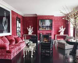 luxury living room with wall upholstered red velvet unique candle