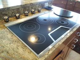 Instead of a hood over the island this cooktop has a pop up vent