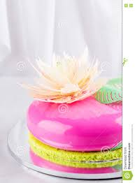 bright pink mousse cake with mirror glaze stock photo image