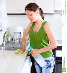happy woman cleaning kitchen furniture stock photo image 57635099