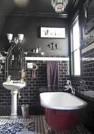 black bathroom designs with black subway tiles and red clawfoot