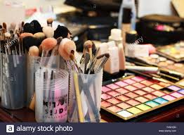 tools for makeup artists table set up of a makeup artist with different cosmetics tools