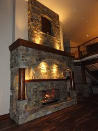 cool neutral stone masonry fireplace design with sweet tile