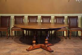 Round Dining Room Tables 54 70 Round Solid Walnut Round Dining Table With Hidden Leaves