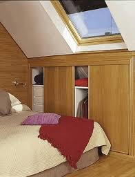 storage solutions for attic bedrooms smooth glowing white wall