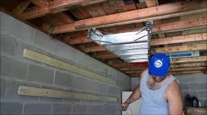 diy ladder storage with bungee cords garage organization youtube