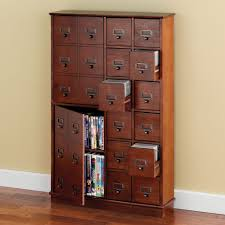 Dvd Storage Cabinet The Space Saving Cd Dvd Storage Cabinet Hammacher Schlemmer