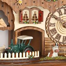 chalet style quartz cuckoo clock with accordion player and cuckoo