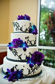 purple and blue wedding white and purple wedding flowers white wedding cake with black