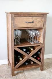 great weathered wood wine cabinet with two drawers and a side door