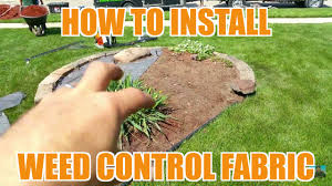 How To Cut Weeds In Backyard How To Install Weed Barrier Fabric Landscaping U0026 Lawn Care Youtube