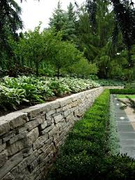 fieldstone retaining wall landscape transitional with boxwood form