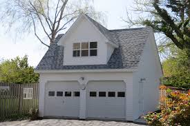 a two car garage with a man cave on the second floor this
