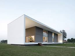 unique shape of a concrete house with modern interior design in