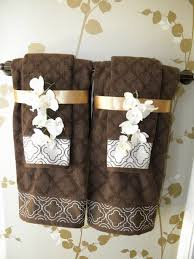bathroom towel folding ideas sew decorative trim to your towels and add coordinating decorative