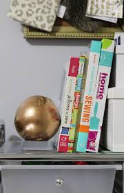 The Nest Home Decor Using An Oversized Wood Pool Ball To Make A Lucite Inspired Bookend