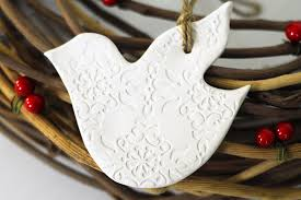 white dove ornament rainforest islands ferry