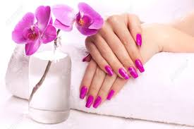 female hands with fragrant orchid and towel spa stock photo
