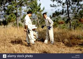 a uxo lao bomb disposal team work on wiring up a bomb for
