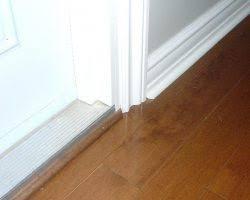 installing spacers between tileslaminate flooring transition at