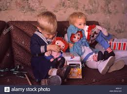 vintage christmas picture from 1960 boy and with raggedy ann