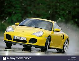 yellow porsche 911 car porsche 911 turbo model year 2000 coupe roadster yellow