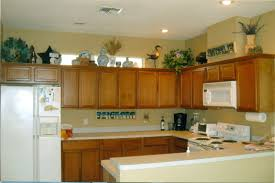 decorate above kitchen cabinets natural unfinished wooden wall