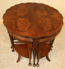 circular nest of figured walnut coffee tables 236923