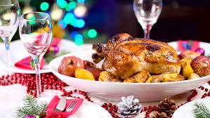 roasted chicken on table in front of fireplace and tree
