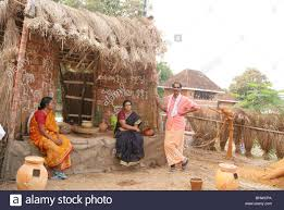 tribal family with their traditional pot tools and works in