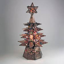 small aged tin lighted tree with marbles