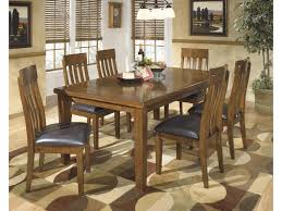 signature design by ashley ralene casual 7 piece dining set with signature design by ashley ralene casual 7 piece dining set with butterfly extension leaf royal furniture dining 7 or more piece sets