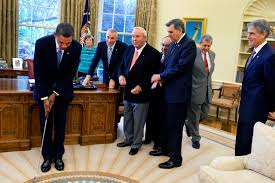 file barack obama takes a practice putt in the oval office jpg