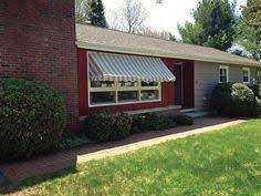 Nulmage Awnings Window Awning Lowered Across Three Double Hung Windows At House