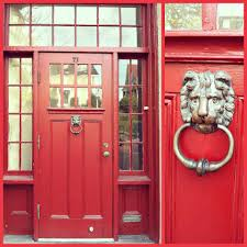 chinese red door with lion knock holder has small glass modern red