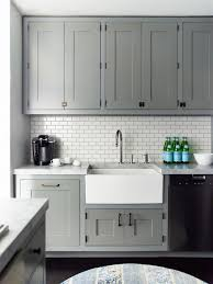 white ceramic subway tile apron sink gray cabinets and grey
